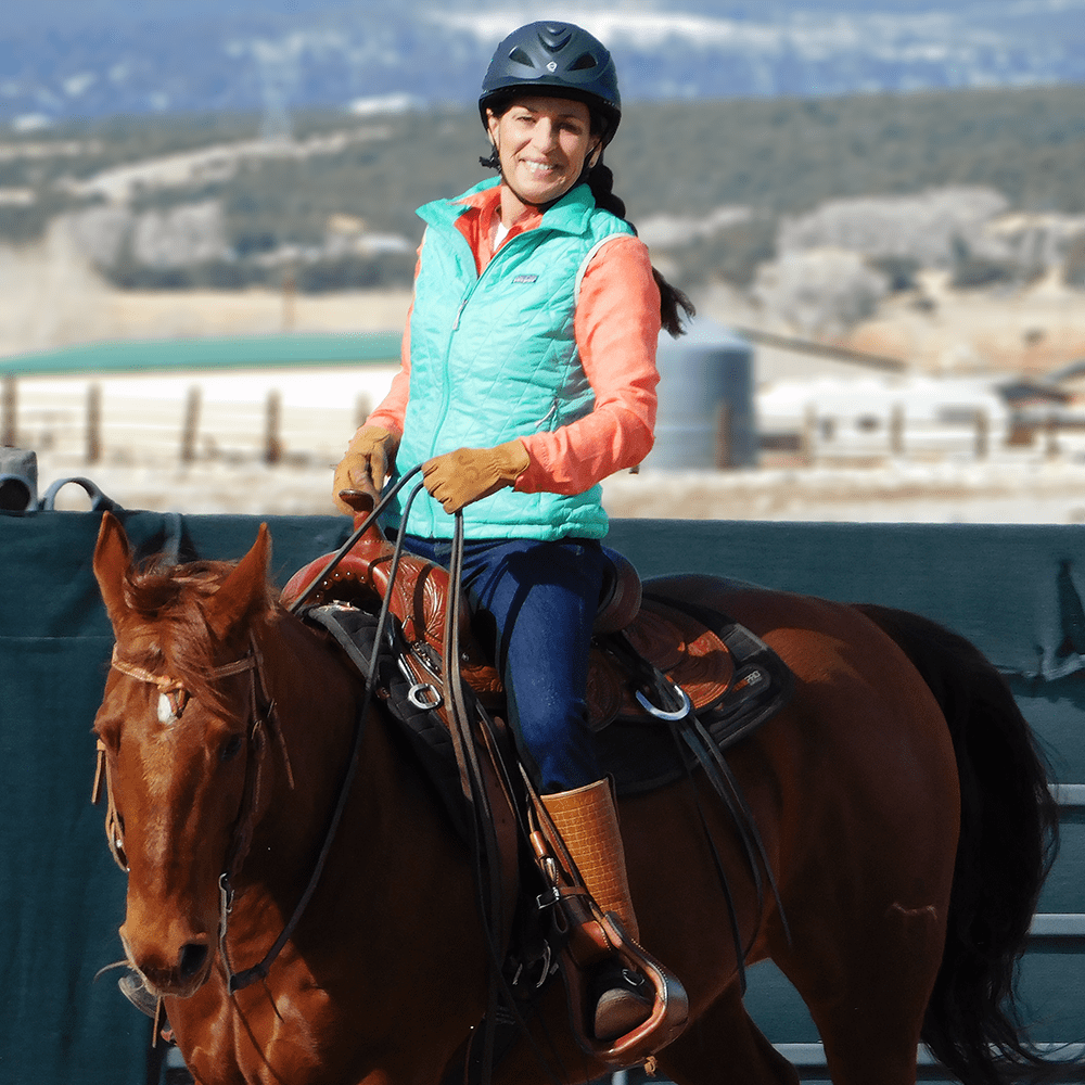Julie riding Annie in the arena