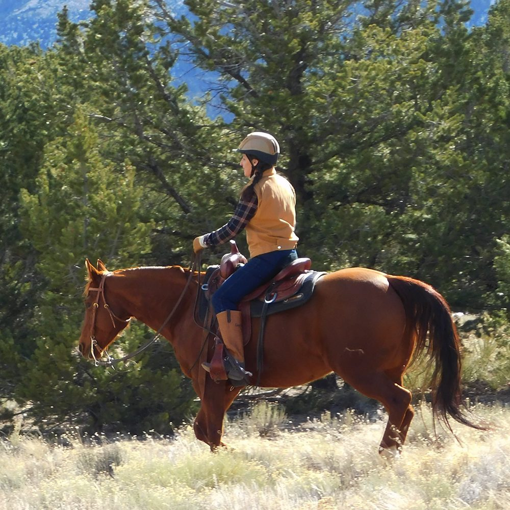 Julie riding in the mountains.
