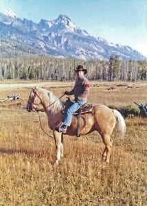 Julie's dad on his palomino trail horse, Scout.