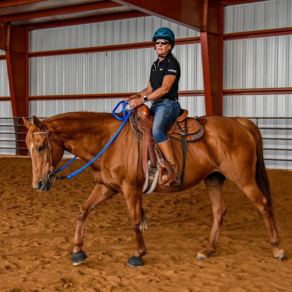 Julie riding Truth in a Western saddle